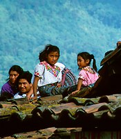 Indigenous family on their roof, Cantel Guatemala