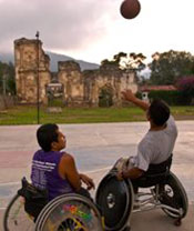 Youth in wheelchairs playing basketball, Antigua, Guatemala